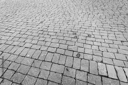 Cuadros en Lienzo Top view on paving stone road