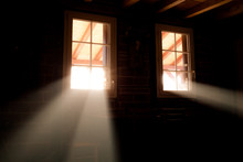 Basement Windows In Wooden Cabin House. Light Beams Passing Through Them