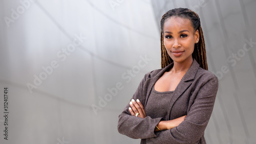 Obraz Banner of African American female company leader CEO boss executive standing confident with ambition and pride, at financial  - fototapety do salonu