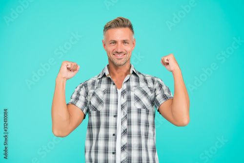 Casual and powerful. Strong guy flex arms blue background. Handsome man in casual style. Casual fashion trends. Fashion and style. Feeling comfortable. Casual look
