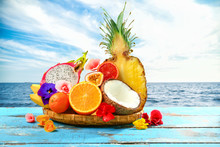 Assortment Of Tasty Exotic Fruits On Wooden Table At Sea Resort