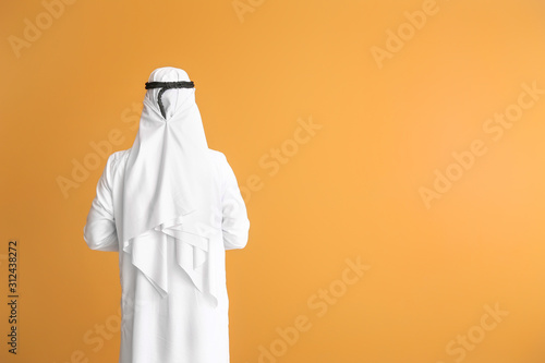 Canvas Print Handsome Arab man on color background, back view