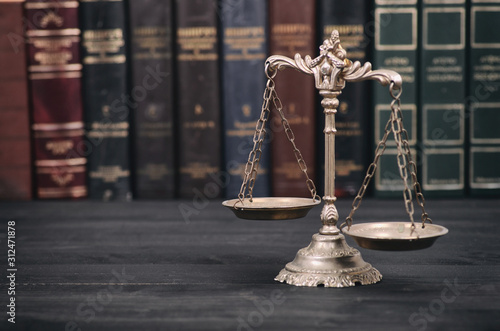 Fototapeta  Scales of Justice on a black wooden background. obraz