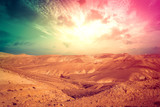 Mountainous desert with colorful cloudy sky. Judean desert, Israel
