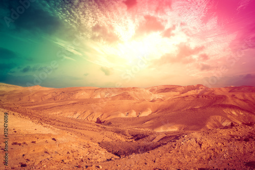 Mountainous desert with colorful cloudy sky Canvas Print