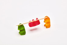 Two Gummy Bears Carrying A Gum...