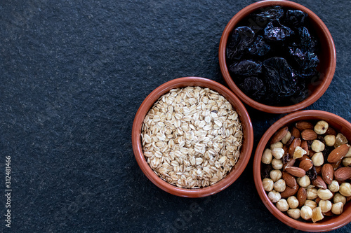 Fototapeta Healty, vegetarian dried fruit breakfast
