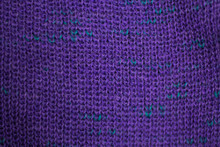 Texture Of Purple Wool Knitted Fabric As Background