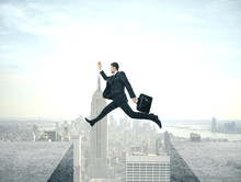 Businessman Jumping From Roof ...