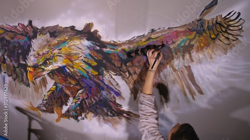 Artist designer draws an eagle on the wall Fototapeta