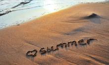 The Word Summer Written On San...