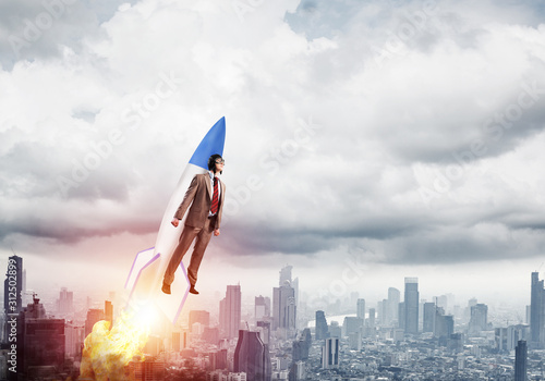 Business person in aviator hat flying on rocket Canvas Print