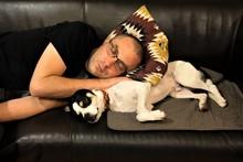 Cute Dog And His Master Sleepi...