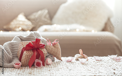 Fototapeta The concept of Valentine's day. Gift box on the table. obraz