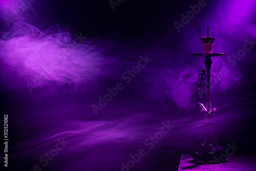 Obraz The classic hookah. Beautiful background, with colored rays of light and smoke. The concept of hookah Smoking. - fototapety do salonu