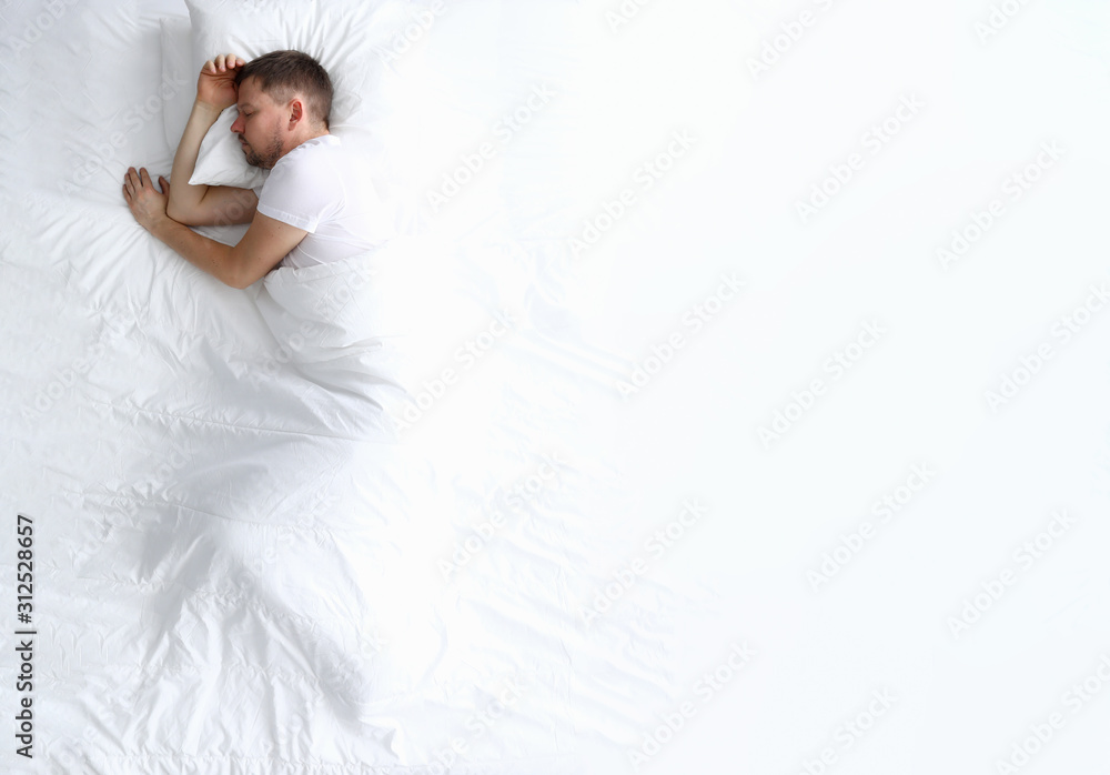 Fototapeta Young caucasian beauty woman sleeping on white bed