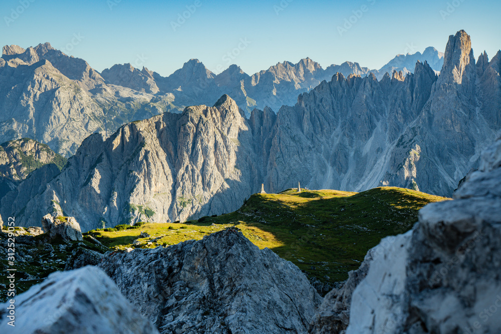 Fototapeta Panoramic view of famous Dolomites mountain peaks glowing in beautiful golden evening light at sunset in summer, South Tyrol, Italy