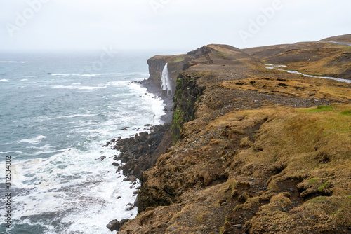 Ketubjorg bird cliffs and waterfall in the Skagi peninsula in Iceland Wallpaper Mural
