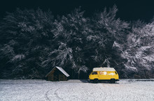 Yellow Camper Van With Winter Forest On Background At Night In Carpathians, Ukraine