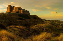 Sunset Over Bamburgh Castle In Northumberland UK Landscape