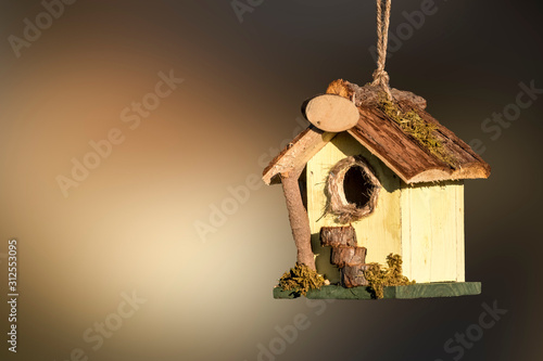 cute birdhouse in the garden Canvas Print