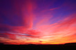 canvas print picture - Very colorful clouds in dramatic sky. Romantic sunset at the countryside.