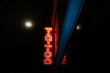 Bright Red Neon Where It Puts Tattoo