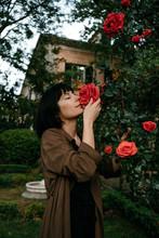 Smelling A Huge Rose