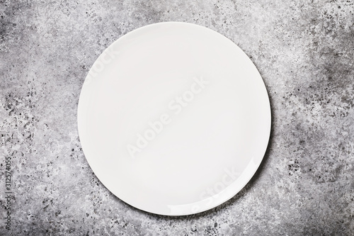 White ceramic tray on a table with concrete texture, top view. Food background