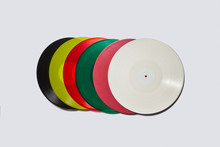 Set Of Colorful Vinyl Records On A Light Gray Background.