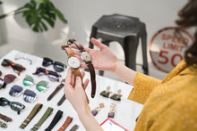 Young Woman Trying Watches In ...