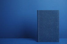 Hardcover Book On Blue Backgro...