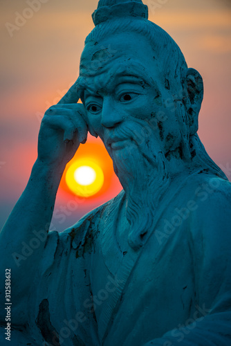 Obraz Chessboard peak statue in Ban Co peak at sunset, Da Nang Vietanm - fototapety do salonu
