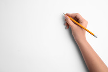 Woman Holding Pencil On White ...