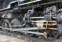 A Close Up Of The Working Gears And Wheels Of A Steam Locomotive