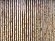 canvas print picture - Wooden thin slats with traces of firing. Thin vertical slats.Wooden background. Abstract background.