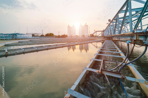 Water treatment plant with sunrise Wallpaper Mural
