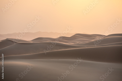 Canvas Print Abstract view of sand dunes in the desert at sunrise