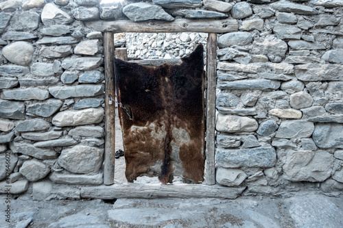 Hide Covered Door in Stone Wall Canvas Print