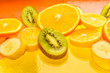 Tropical Fruit slices on the yellow background - stock photo