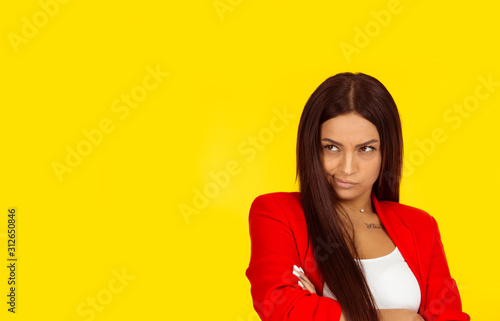 Displeased suspicious young woman looking to the side Wallpaper Mural