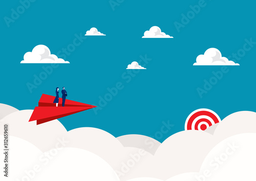 Photo  Two business standing on red paper plane flying on sky go to success goal