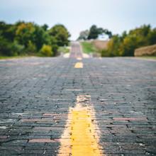 Old Brick Road Through Farmland