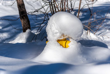 Community Neighborhood Fire Hydrant Is Almost Completey Covered In A Mound Of Fresh Snow After Winter Storm Passes Through The Small Rural Town Of Wrightwood, California.