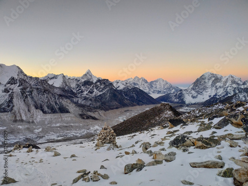 Obraz na plátně  Taboche, Kangtega and Ama Dablam mountain peaks rises above Khumbu glacier and valley covered with clouds in the early morning in Himalayas
