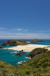 The remote Cape Maria Van Diemen and bright blue sea on the Cape Reinga, Northland, New Zealand.