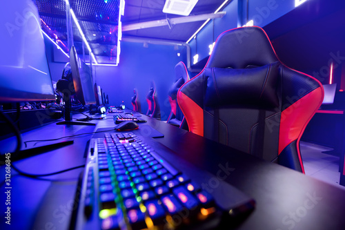 Professional gamers cafe room with powerful personal computer game chair blue color Canvas Print