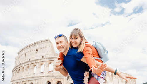 Travel couple man and girl taking selfie photo Colosseum landmark in Rome city Canvas Print