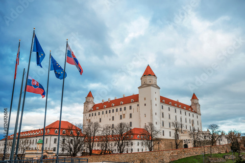 Bratislava Castle with flags of Slovakia and the European Union in Bratislava Wallpaper Mural