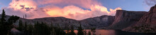 Panorama Of Pink Sunset On Mountain Lake